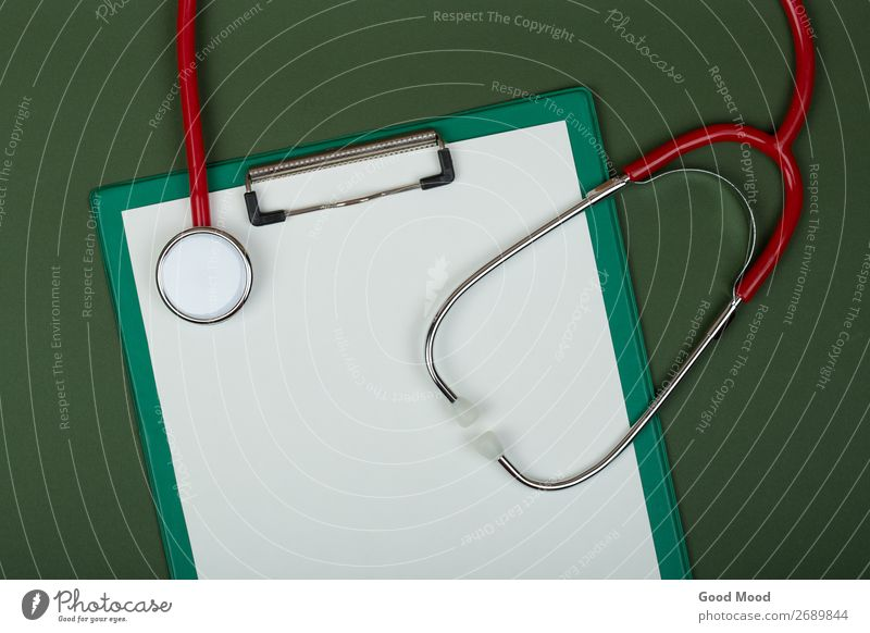 red stethoscope and empty clipboard on green Green White Red Health care Metal Vantage point Heart Paper Document Listening Medication Science & Research Doctor