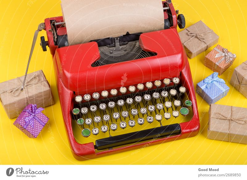 red typewriter with blank craft paper, gift boxes on yellow Old Christmas & Advent Red Adults Yellow Feasts & Celebrations Business Copy Space Retro Technology