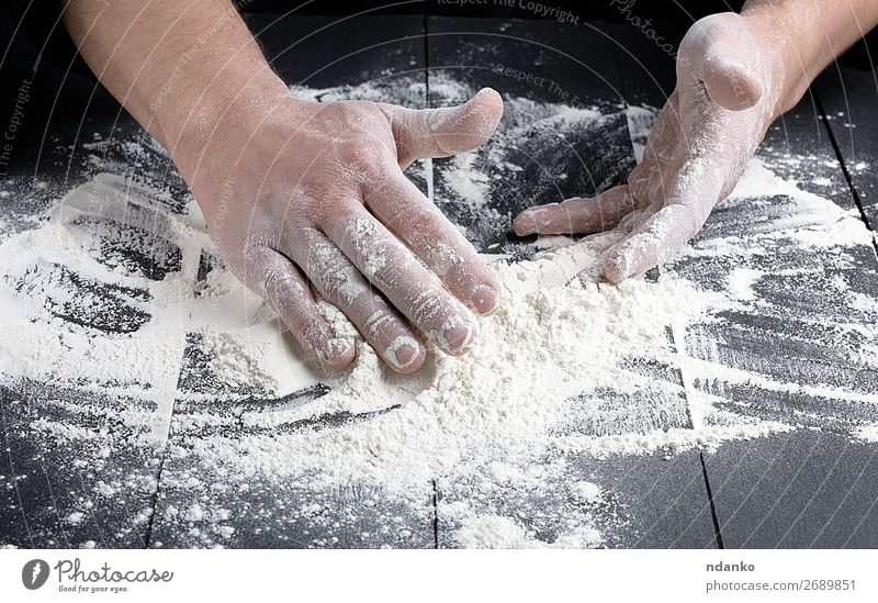 white wheat flour on a black wooden table Dough Baked goods Bread Kitchen Cook Human being Man Adults Hand Wood Make Dark Fresh Black White Baker Bakery Baking