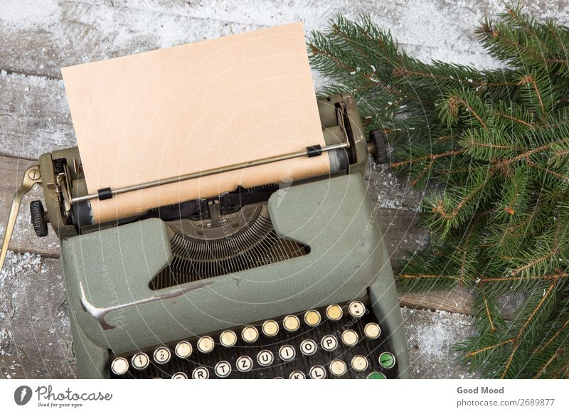 workplace with a typewriter and spruce branches on wooden table Winter Snow Feasts & Celebrations Christmas & Advent Workplace Office Business Technology Tree