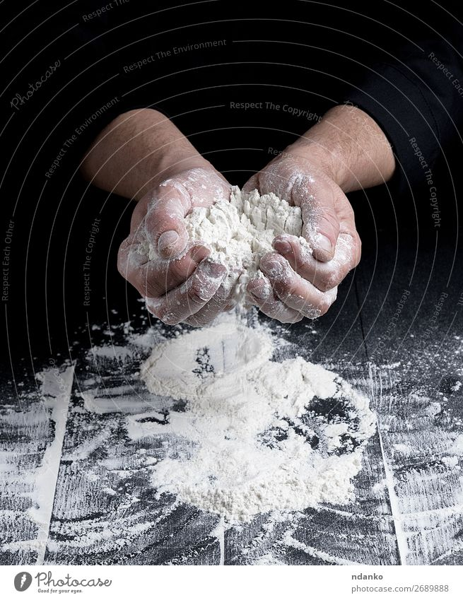 white wheat flour in male hands Human being Man White Hand Dark Black Adults Wood Table Kitchen Baked goods Profession Cooking Bread Make Meal