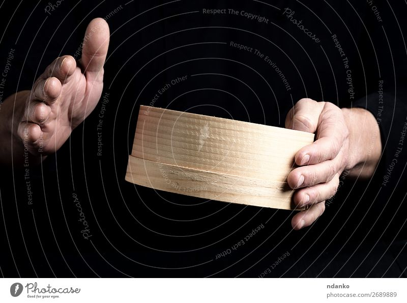 two male chef hands hold a round wooden sieve Dough Baked goods Bread Nutrition Table Kitchen Human being Man Adults Hand Sieve Wood Make Dark Fresh Black White