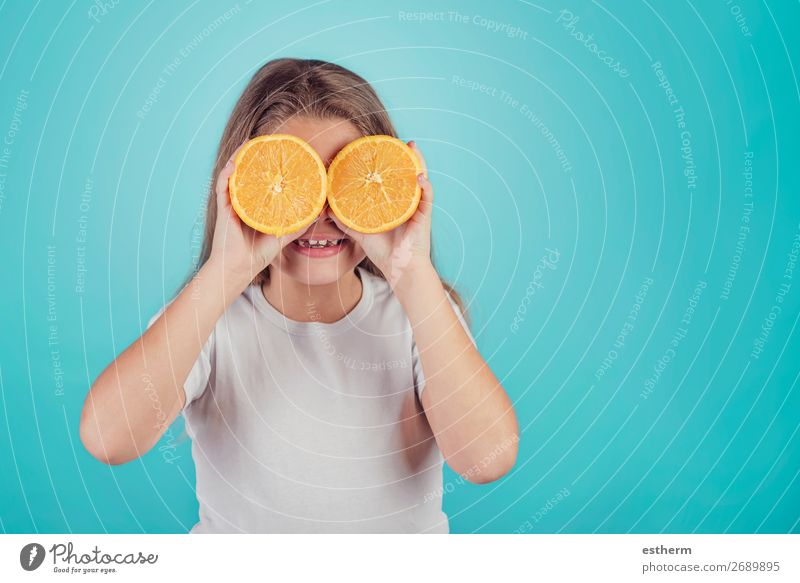 smiling little girl holding oranges over her eyes Fruit Dessert Nutrition Lunch Vegetarian diet Diet Juice Lifestyle Joy Human being Feminine Girl Infancy 1
