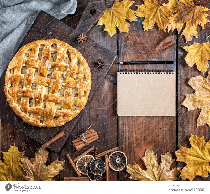 baked whole round apple pie on a brown wooden board Fruit Apple Cake Dessert Table Kitchen Autumn Leaf Wood Fresh Brown Yellow Tradition Pencil American Baking