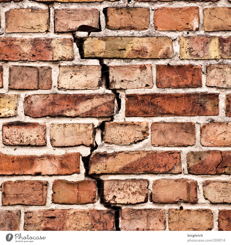 cracked wall Wall (barrier) Wall (building) Brick Brick construction Stone Red dissension crack in the wall Colour photo Exterior shot Deserted Day