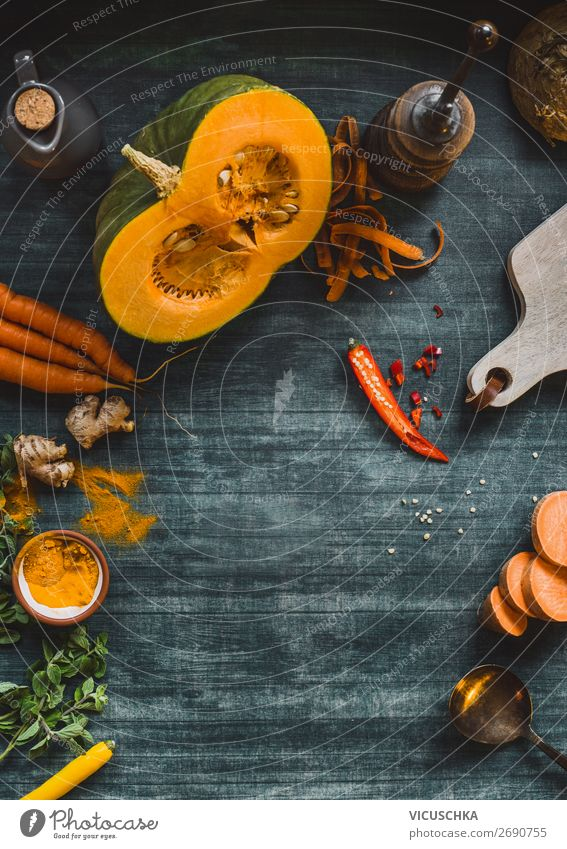 Food background frame with pumpkin and orange color vegetables on kitchen table, top view. Autumn  cooking food place design menu recipes autumn winter healthy
