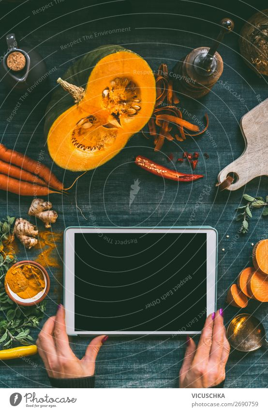 Hands with tablet PC on kitchen table with pumpkin Food Vegetable Nutrition Organic produce Vegetarian diet Crockery Design Healthy Eating Table Restaurant