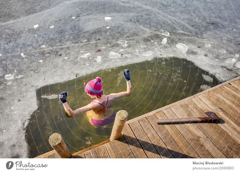 Fit woman performs ice swim in the ice hole. Woman Human being Nature Winter Healthy Lifestyle Adults Cold Sports Lake Swimming & Bathing Leisure and hobbies