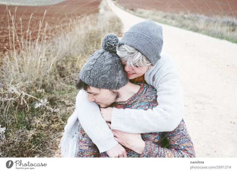 Couple of young happy people hugging Woman Human being Vacation & Travel Nature Man Beautiful Clouds Joy Lifestyle Adults Love Lanes & trails Feminine Emotions