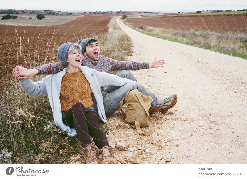 Couple of young hugging and shouting Woman Human being Vacation & Travel Nature Man Beautiful Clouds Joy Winter Lifestyle Adults Autumn Love Lanes & trails