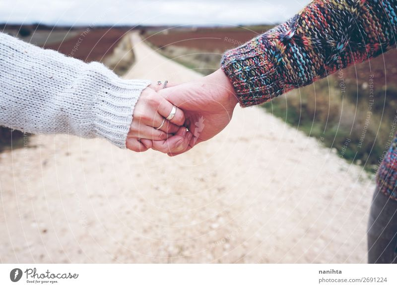 Closeup of a young couple holding hands Woman Human being Vacation & Travel Nature Youth (Young adults) Man Beautiful Hand Clouds Joy 18 - 30 years Lifestyle