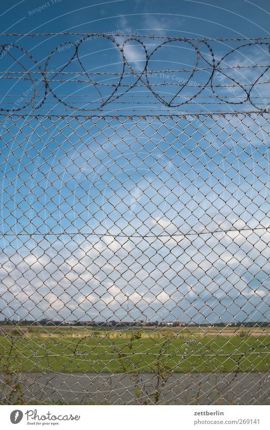 Landscape behind a fence Environment Nature Sky Clouds Summer Climate Climate change Weather Beautiful weather Town Places Looking Longing Homesickness