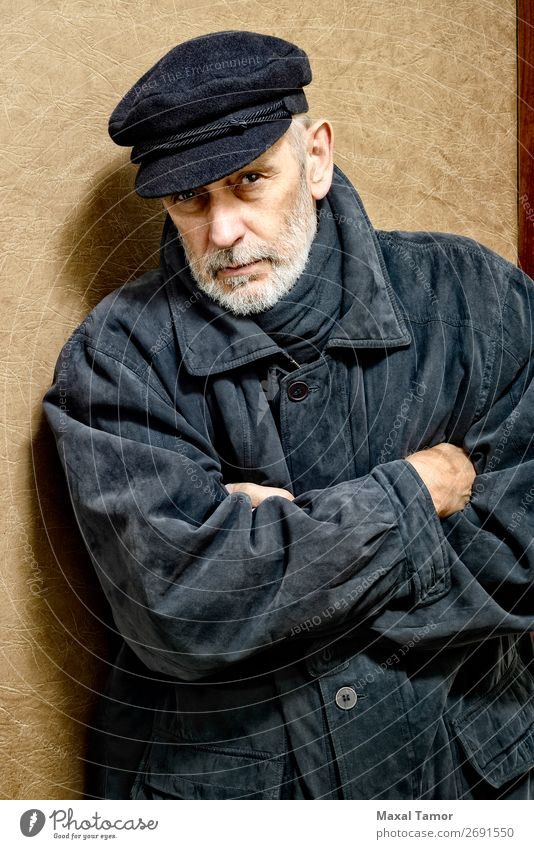 Portrait of a Man with Beard and a Cap Face Ocean Homosexual Adults Jacket Coat Leather Scarf Old Cool (slang) Strong Black White attractive bad bad boy bandit