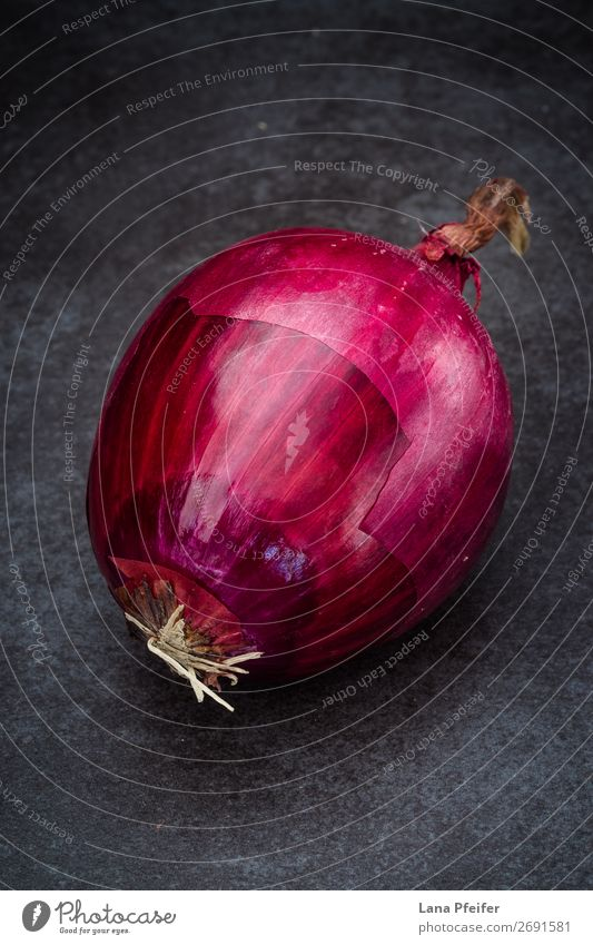 Red onion in close up Food Vegetable Fruit Nutrition Eating Kitchen Dark Fresh Bright Natural Colour background Ingredients one Onion recipe Surface Unpeeled