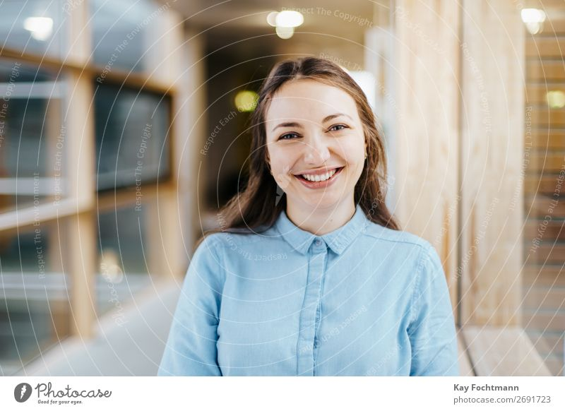Laughing young woman with long brown hair Joy Happy Study University & College student Work and employment Profession Office Economy Media industry