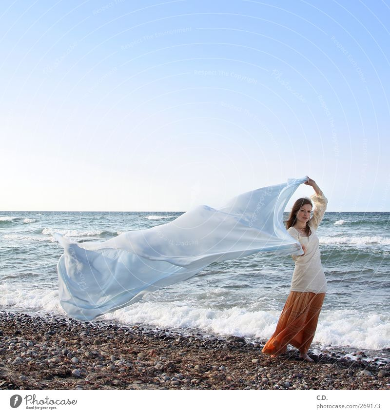 On the beach Young woman Youth (Young adults) 1 Human being 18 - 30 years Adults Water Sky Cloudless sky Waves Beach Baltic Sea Skirt Long-haired Esthetic Free