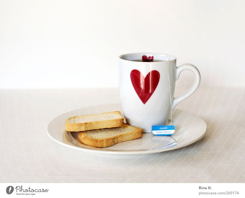 6 minutes (Schonkost III ) Dough Baked goods zwieback Hot drink Tea Plate Mug Heart Red White Healthy Teabag camomile tea Colour photo Interior shot Deserted