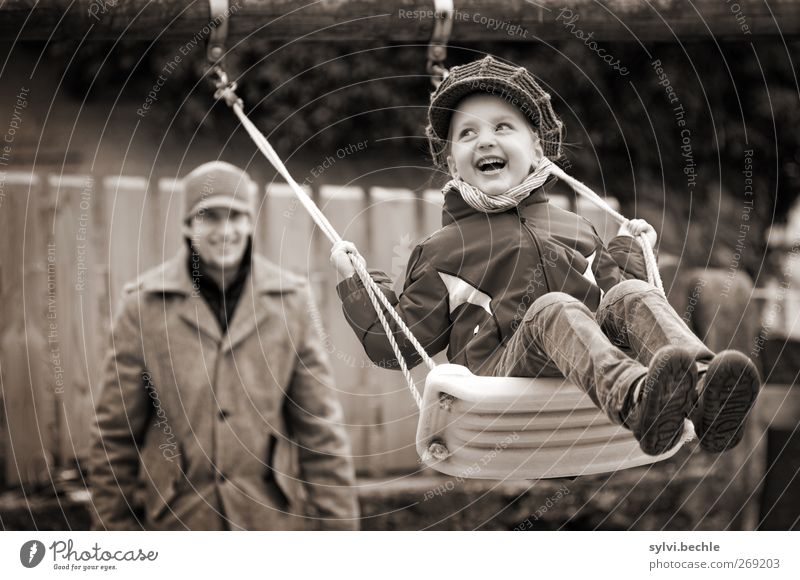 happy childhood, child on the swing Joy Leisure and hobbies Playing Human being Masculine Feminine Child Girl Young man Youth (Young adults) Father Adults