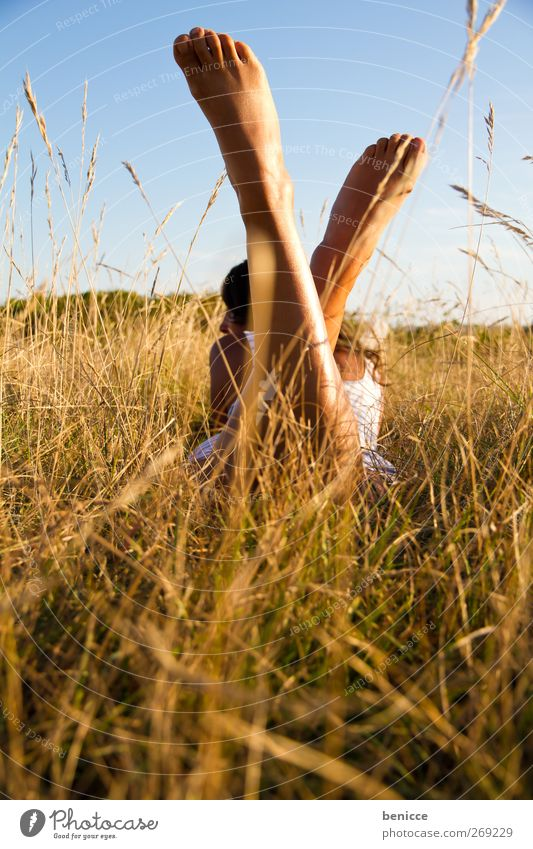 Summer at last Woman Human being 1 Person Lie Meadow Relaxation Spring Dress Grass Loneliness Feet Legs Shaven Sun Sunbeam Day Sunlight European Reading Nature