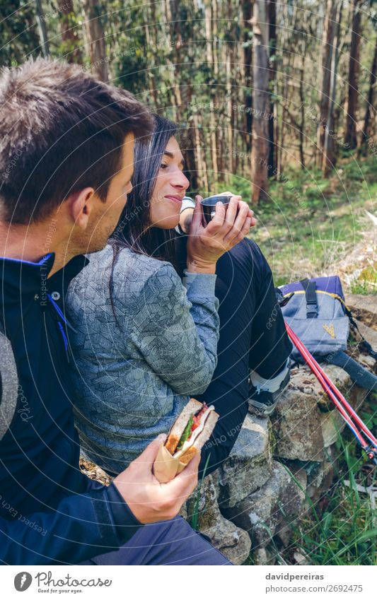 Couple pausing while doing trekking Eating Drinking Lifestyle Leisure and hobbies Vacation & Travel Adventure Mountain Hiking Sports Climbing Mountaineering