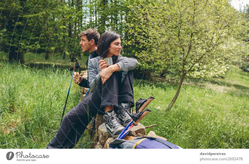 Couple pausing while doing trekking Eating Drinking Lifestyle Leisure and hobbies Adventure Mountain Hiking Sports Climbing Mountaineering Human being Woman