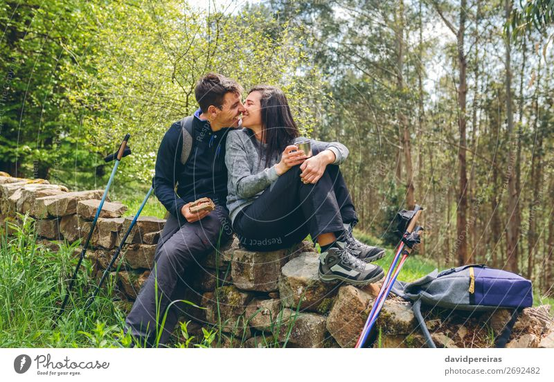 Couple about to kiss while making a break to do trekking Eating Drinking Lifestyle Leisure and hobbies Adventure Mountain Hiking Sports Human being Woman Adults