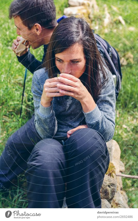 Couple pausing while doing trekking Eating Drinking Coffee Lifestyle Leisure and hobbies Vacation & Travel Adventure Mountain Hiking Sports Climbing