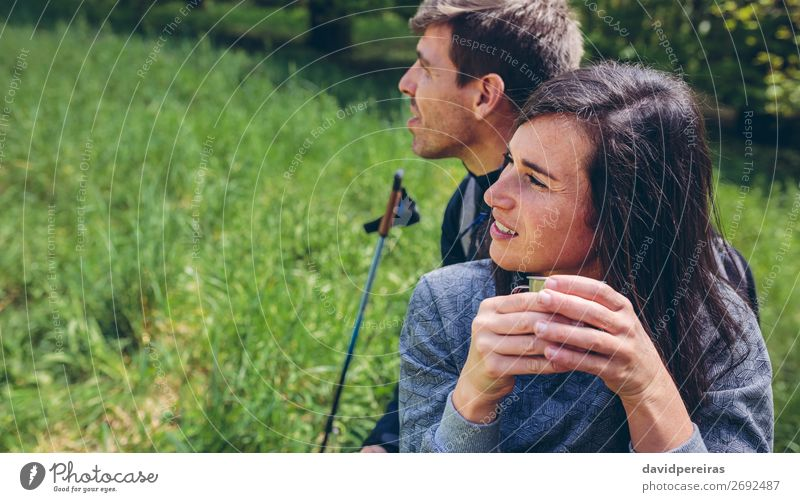 Couple pausing while doing trekking Drinking Coffee Lifestyle Leisure and hobbies Adventure Mountain Hiking Sports Climbing Mountaineering Human being Woman