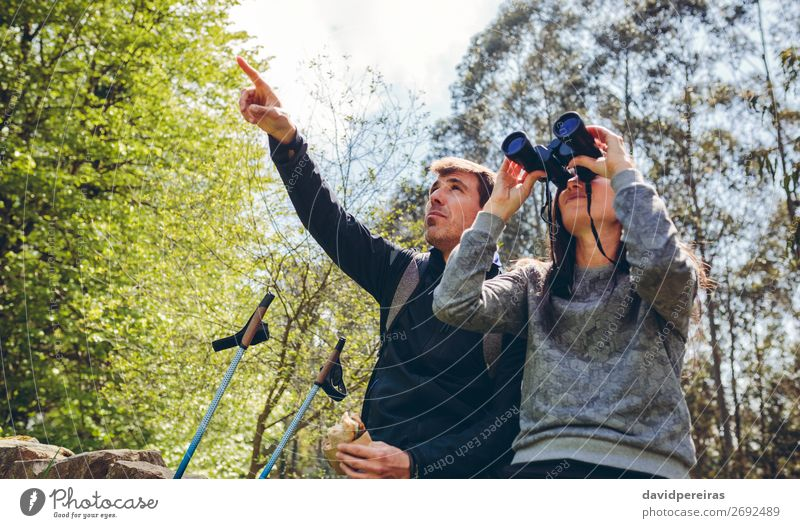 Couple doing trekking looking with binoculars Eating Lifestyle Leisure and hobbies Adventure Hiking Sports Human being Woman Adults Man Nature Landscape Autumn