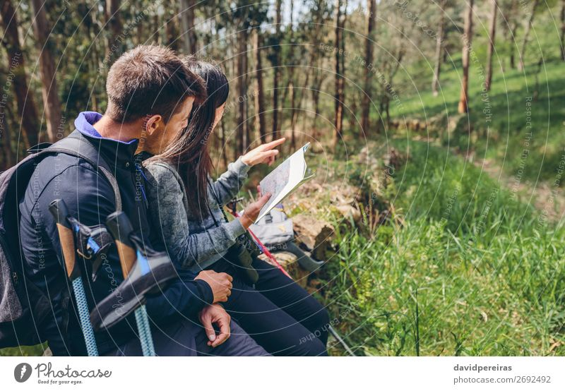Couple doing trekking sitting looking at a map Lifestyle Trip Adventure Sightseeing Mountain Hiking Sports Human being Woman Adults Man Nature Landscape Autumn