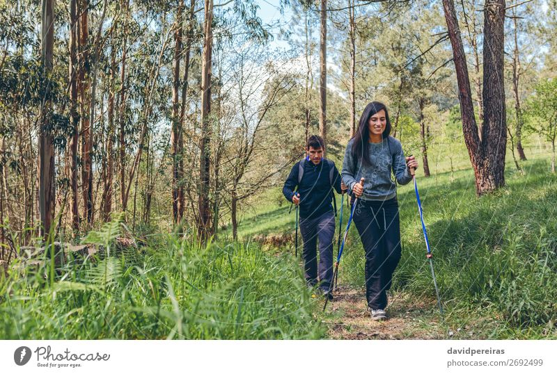 Couple of hikers doing trekking Lifestyle Happy Vacation & Travel Trip Adventure Mountain Hiking Sports Climbing Mountaineering Human being Woman Adults Man