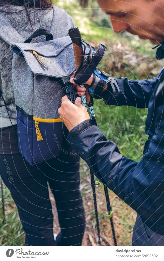 Hiker closing his partner's backpack Lifestyle Vacation & Travel Trip Adventure Mountain Hiking Sports Climbing Mountaineering Human being Woman Adults Man