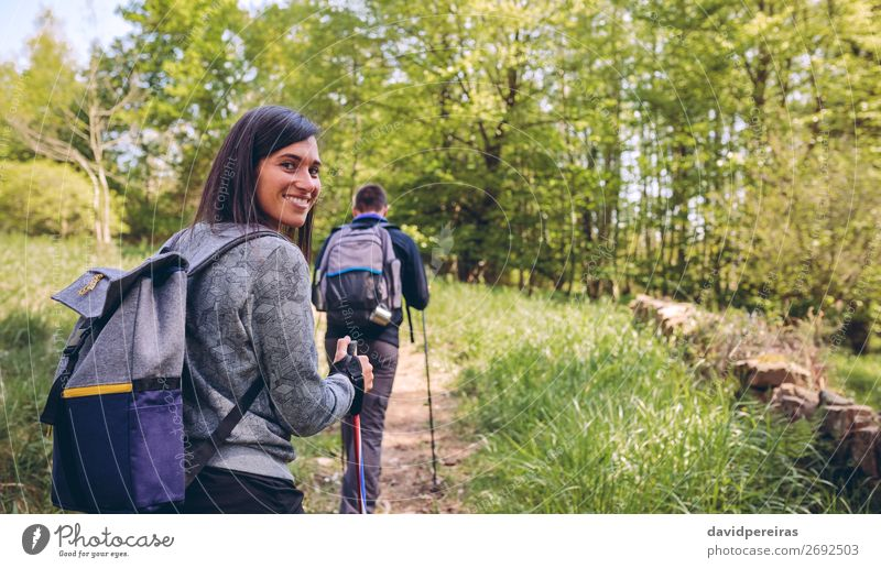 Woman doing trekking looking at camera Human being Vacation & Travel Nature Man Beautiful Landscape Tree Joy Forest Mountain Lifestyle Adults Autumn