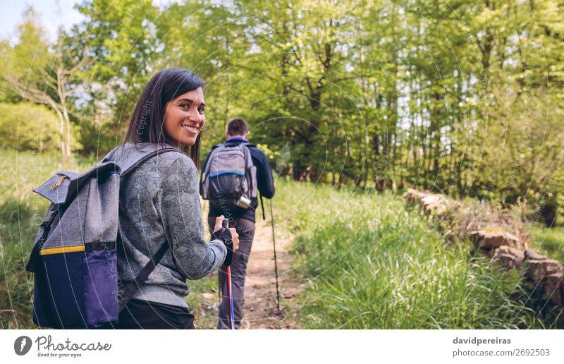 Woman doing trekking looking at camera Lifestyle Joy Happy Beautiful Vacation & Travel Trip Adventure Mountain Hiking Sports Climbing Mountaineering Human being