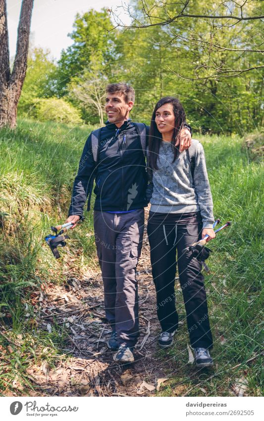 Hikers walking embraced Lifestyle Happy Trip Adventure Hiking Sports Climbing Mountaineering Human being Woman Adults Man Couple Nature Landscape Autumn Tree