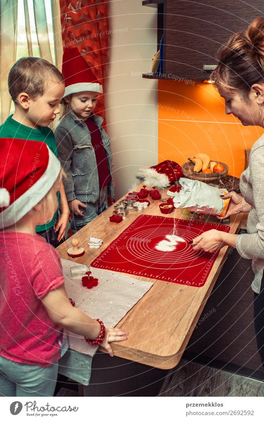 Baking Christmas cookies at home Woman Child Human being Christmas & Advent Girl Lifestyle Adults Family & Relations Feasts & Celebrations Boy (child) Group