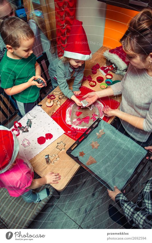 Baking Christmas cookies at home Dough Baked goods Cake Dessert Candy Lifestyle Table Kitchen Feasts & Celebrations Christmas & Advent Human being Child Girl