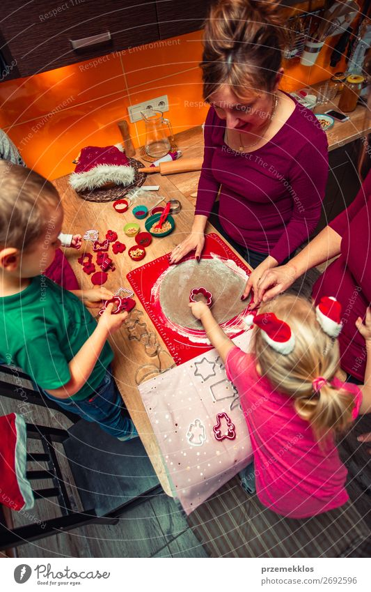 Baking Christmas cookies at home Woman Child Human being Christmas & Advent Girl Food Lifestyle Adults Family & Relations Feasts & Celebrations Boy (child)
