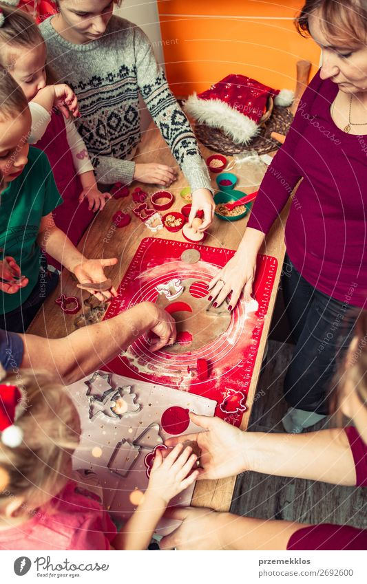 Baking Christmas cookies at home Woman Child Human being Christmas & Advent Joy Girl Food Lifestyle Adults Family & Relations Feasts & Celebrations Boy (child)