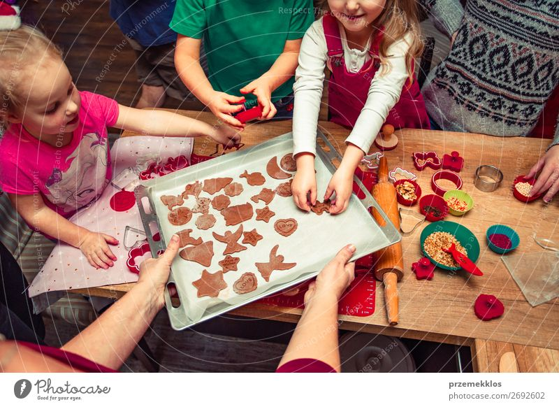 Baking Christmas cookies at home Woman Child Human being Christmas & Advent Beautiful Joy Girl Food Adults Family & Relations Feasts & Celebrations Boy (child)