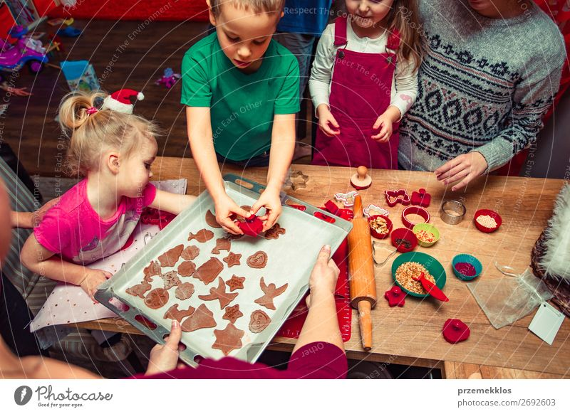 Baking Christmas cookies at home Child Human being Christmas & Advent Girl Food Lifestyle Family & Relations Happy Feasts & Celebrations Boy (child) Infancy