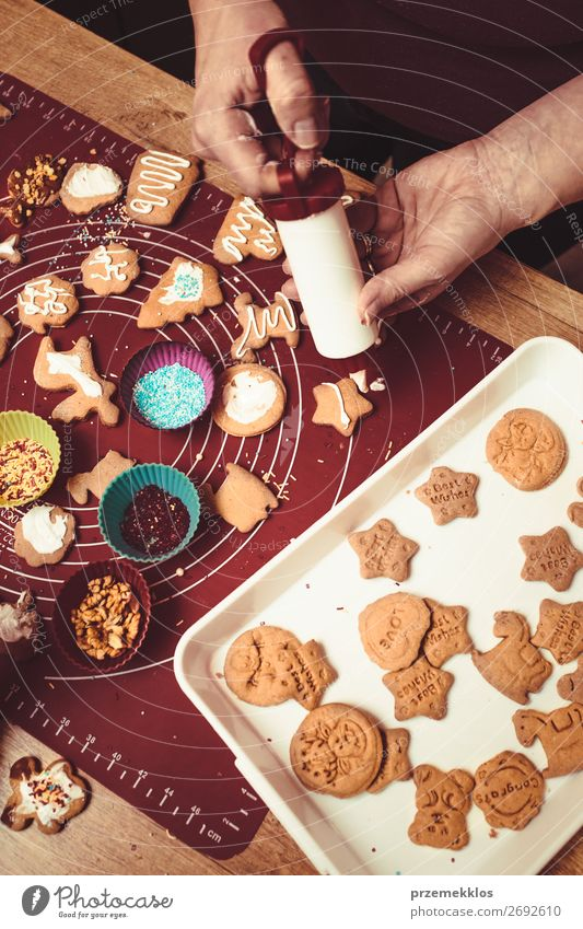 Baking Christmas cookies at home Food Dough Baked goods Cake Candy Lifestyle Table Kitchen Feasts & Celebrations Human being Woman Adults Mother Hand