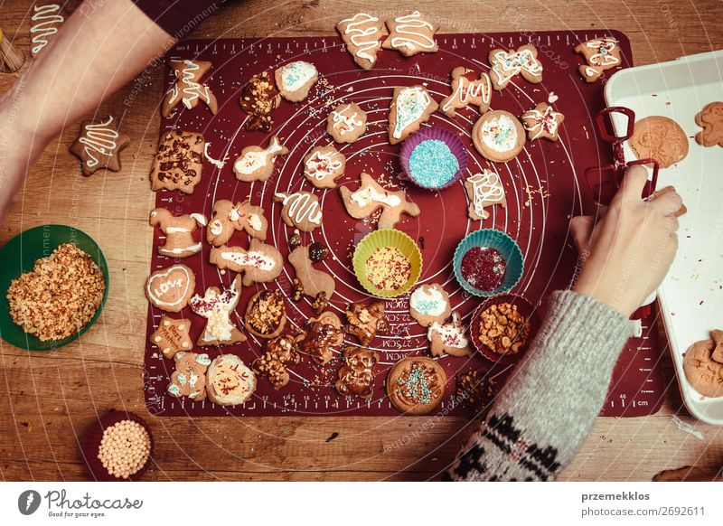 Baking Christmas cookies at home Woman Child Human being Youth (Young adults) Hand Food Lifestyle Adults Family & Relations Feasts & Celebrations Above Design