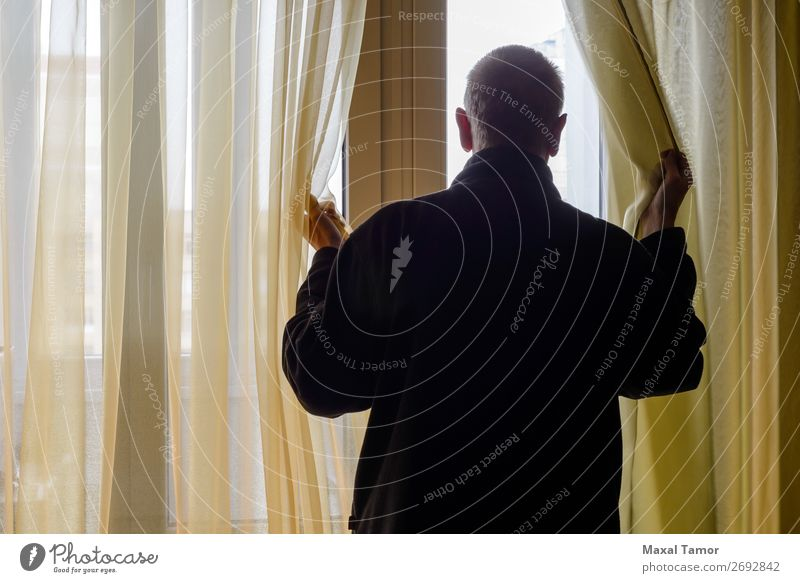 Man Looking out of the Window Human being Adults Observe Think Stand Wait backlight backlit Caucasian Curtain Home interior move observing Ready room