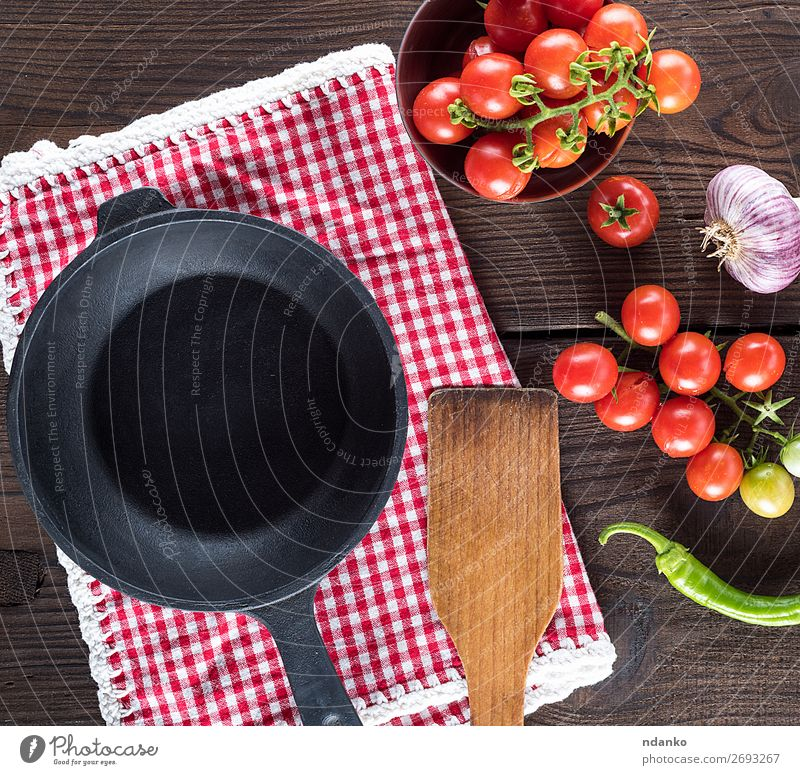 empty round black frying pan, top view Vegetable Herbs and spices Nutrition Lunch Vegetarian diet Pan Summer Table Kitchen Fresh Small Natural Above Green Red