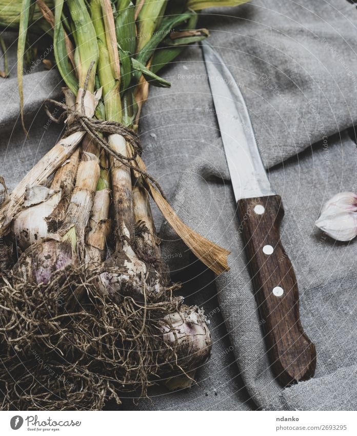 young garlic tied in a bundle Nature Plant Green White Leaf Wood Natural Brown Nutrition Fresh Table Herbs and spices Vegetable Vegetarian diet Knives Rustic