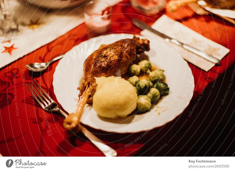 plate with goose, dumplings and Brussels sprouts as a traditinional german christmas dish baked bowl brussel sprouts celebration christmas dinner cook crispy