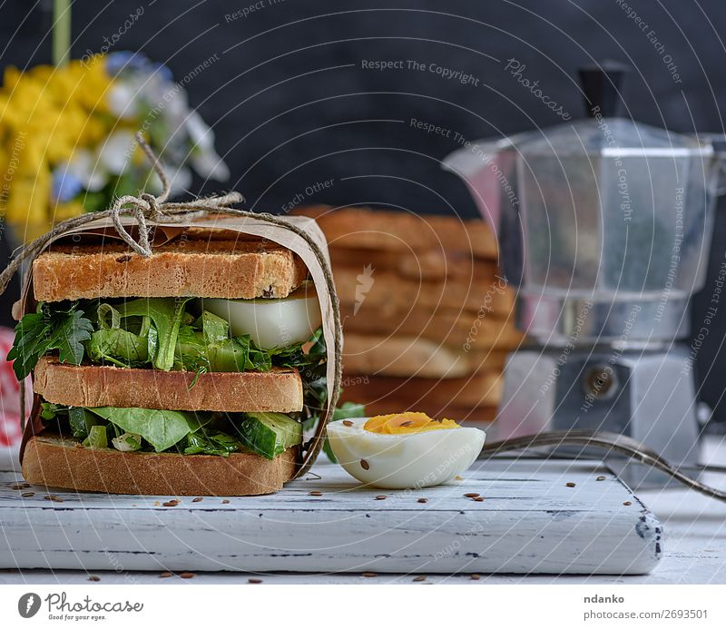 sandwich of French toast and lettuce leaves and boiled egg Meat Vegetable Bread Breakfast Lunch Dinner Vegetarian diet Fast food Table Wood Fresh Delicious