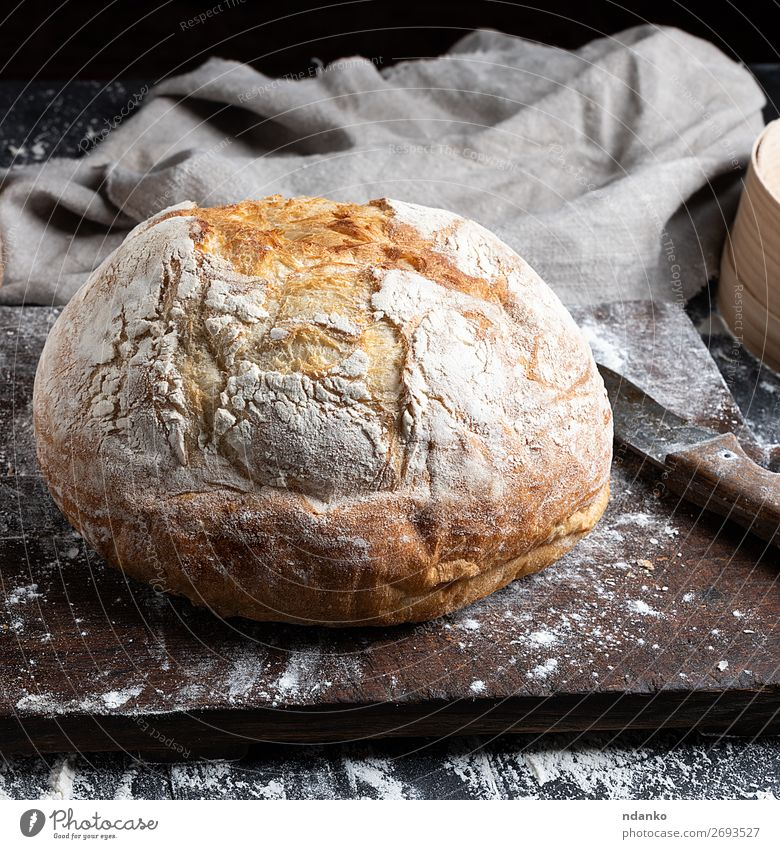 whole baked round bread Bread Nutrition Knives Table Kitchen Wood Make Dark Fresh Brown Black White Tradition Baking Bakery board cooking Chopping board Flour