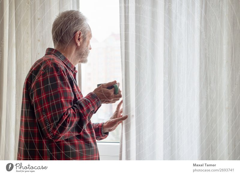 Mature man drinking his coffee and looking out of the window Drinking Coffee Tea Human being Man Adults Town Observe Think Stand Wait Green Red White Caucasian